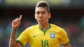 Firmino celebrates after scoring the opening goal during the international friendly match between Brazil and Chile at the Emirates Stadium on March 29, 2015  (Photo by Paul Gilham/Getty Images)